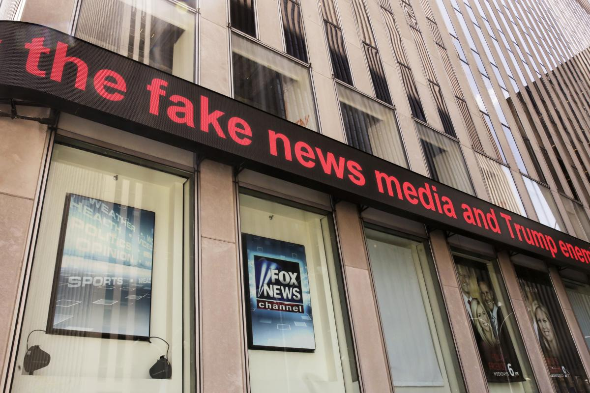 News headlines scroll above the Fox News studios in the News Corporation headquarters building in New York in 2017.