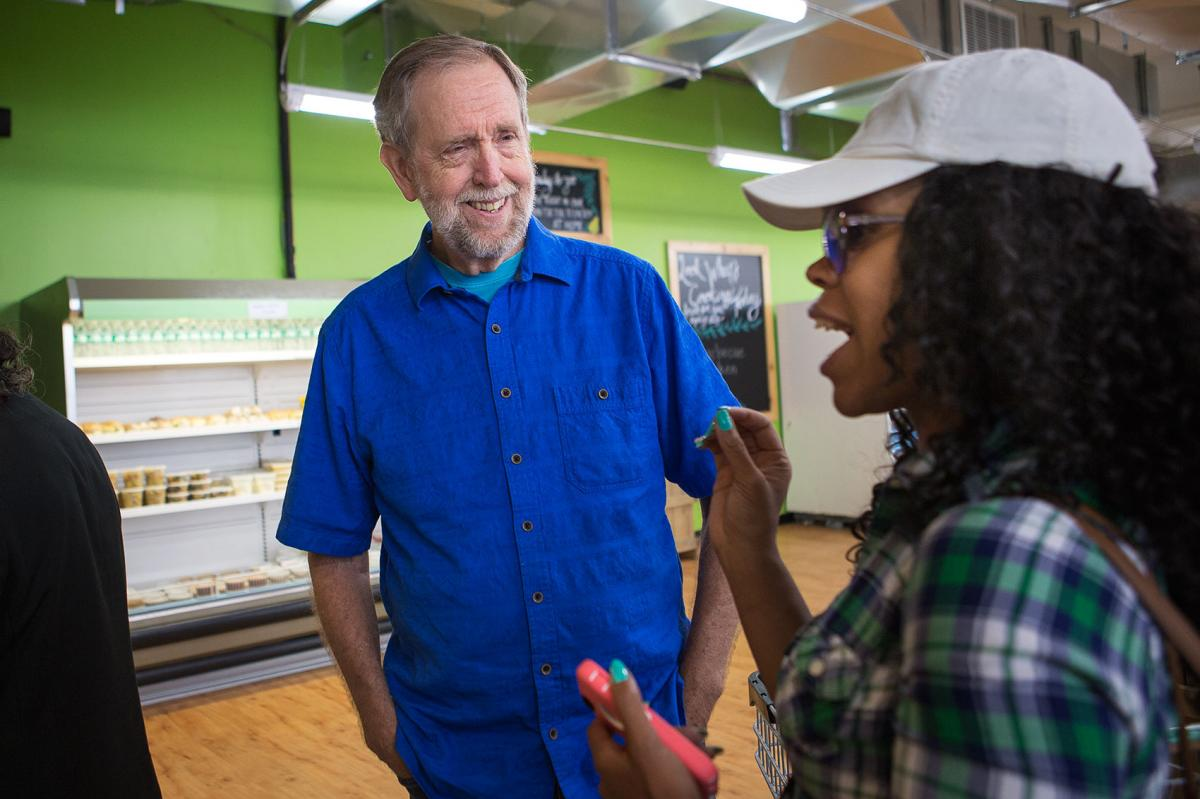 Daily Table founder Doug Rauch greets Latoya Rush after she walks into the store.