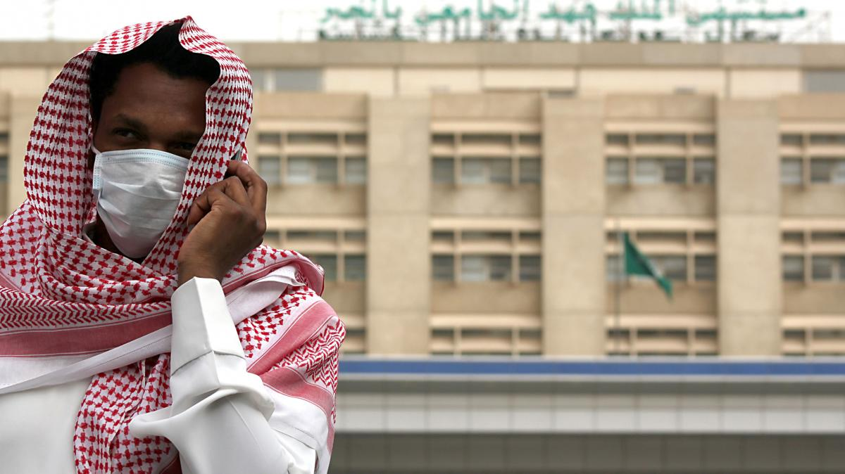 A man outside a hospital in Dammam, Saudi Arabia, wears a surgical mask as a precaution against a coronavirus that has killed 31 people worldwide.