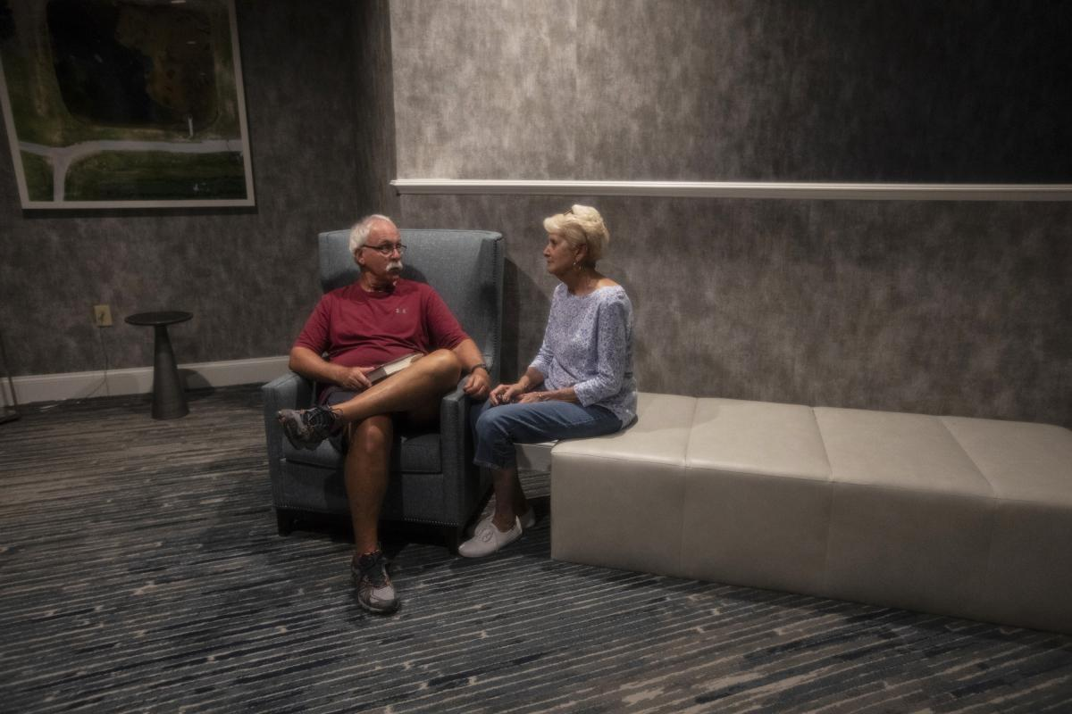 """George and Zelda Allen find a quiet corner in the Hotel Ballast. The Allens live in Hampstead, northeast of Wilmington, and checked in on Wednesday to seek refuge from the storm. They stayed home during Hurricane Hugo and felt it was too """"nerve-wracking"""""""
