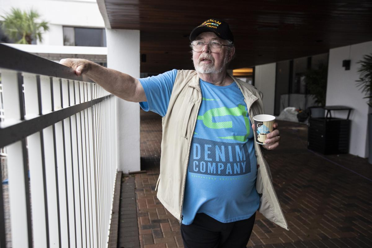 Ray Ryan gets some fresh air outside the hotel, where he and his wife, Ruth, went after being forced to evacuate their beach home.