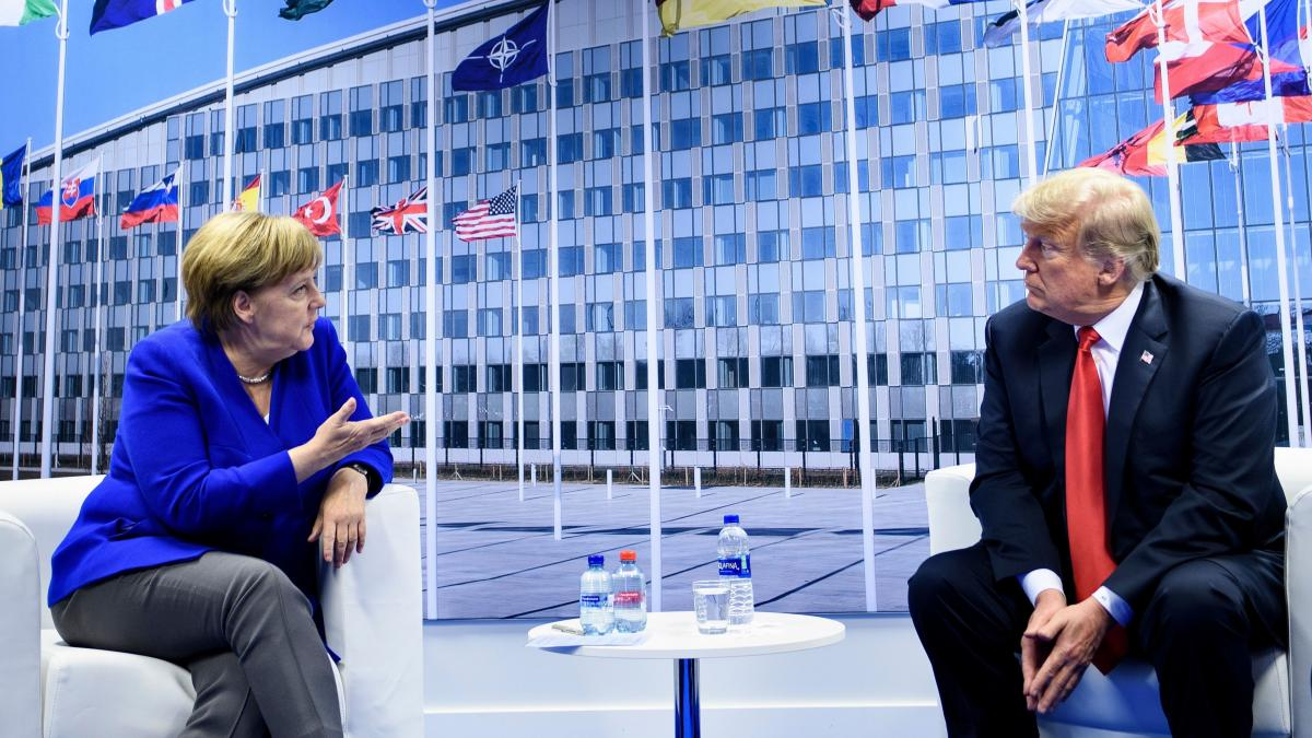 German Chancellor Angela Merkel and President Trump make a statement to the press after a bilateral meeting on the sidelines of the NATO summit in Brussels on Wednesday.