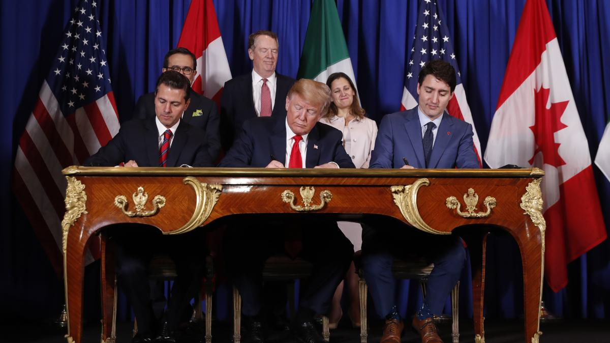 Mexican President Enrique Peña Nieto, Trump and Canadian Prime Minister Justin Trudeau sign the U.S.-Mexico-Canada Agreement — a replacement to NAFTA — Friday at the G-20 summit in Argentina.