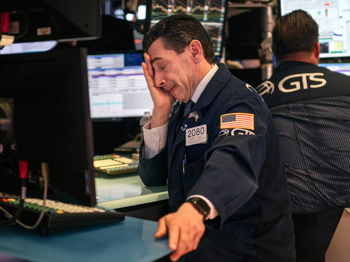 Traders at the New York Stock Exchange react at the end of the worst week on Wall Street since 2008.