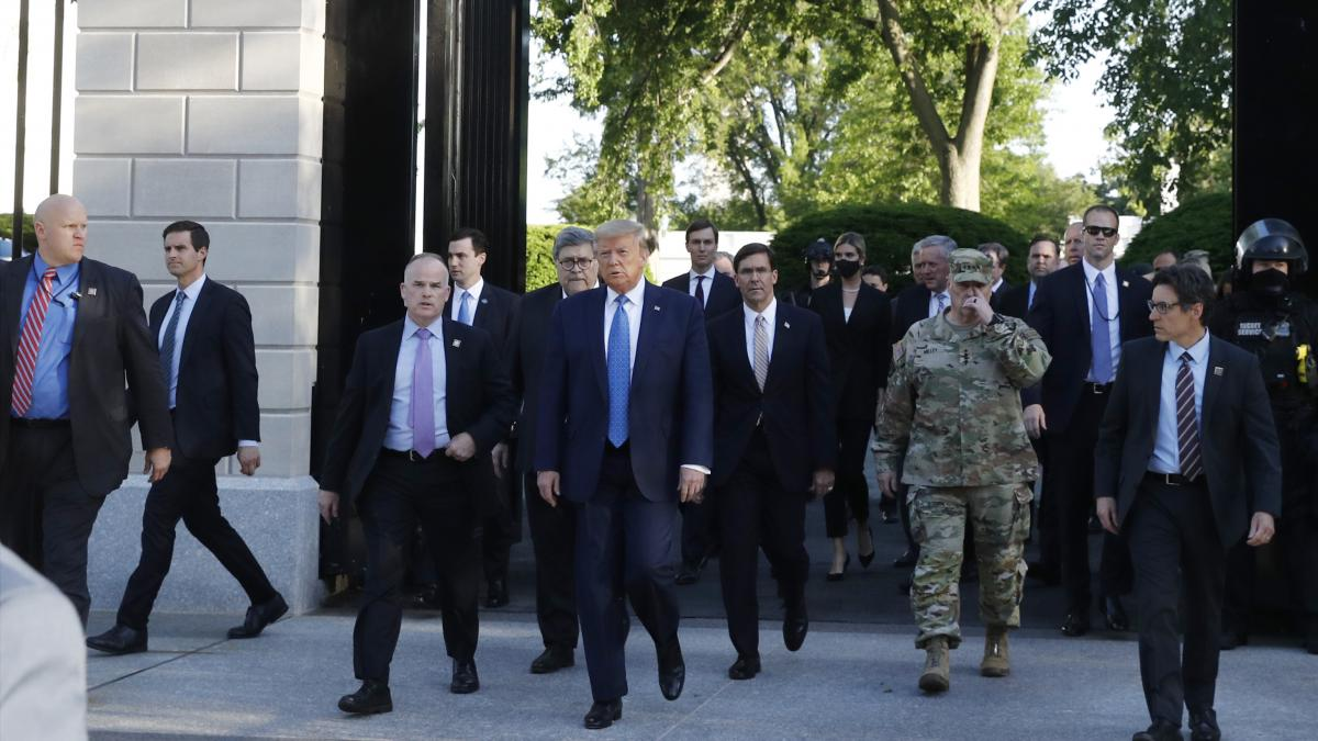 President Trump exits the gates of the White House Monday evening to visit St. John's Church across Lafayette Park.