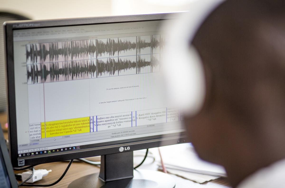 A staffer at Pulse Lab Kampala works on the development of the radio analysis tool. To build the models necessary for speech recognition, hours of audio in each language had to be carefully transcribed.