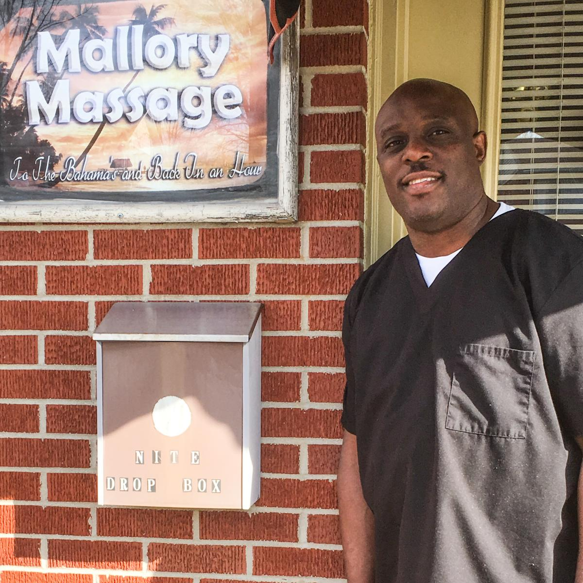 Steven Mallory stands outside his massage clinic.