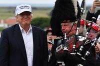 A bagpipe player wears traditional dress next to presumptive Republican presidential nominee Donald Trump at the Trump Turnberry Resort in Ayr, Scotland on Friday.