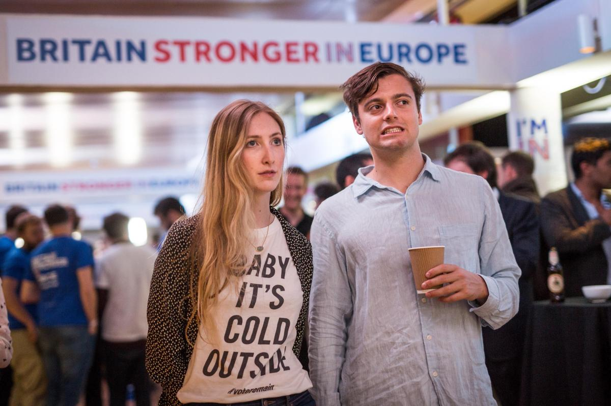"""Supporters of the """"Stronger In""""Campaign react as results of the EU referendum are announced at a results party at the Royal Festival Hall in London early Friday morning."""