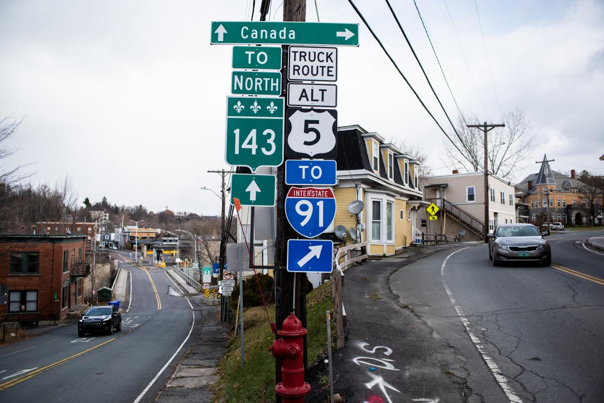 Road signs indicate the many ways to get to Canada from the center of Derby Line, Vt. The number of illegal crossers is on the rise.