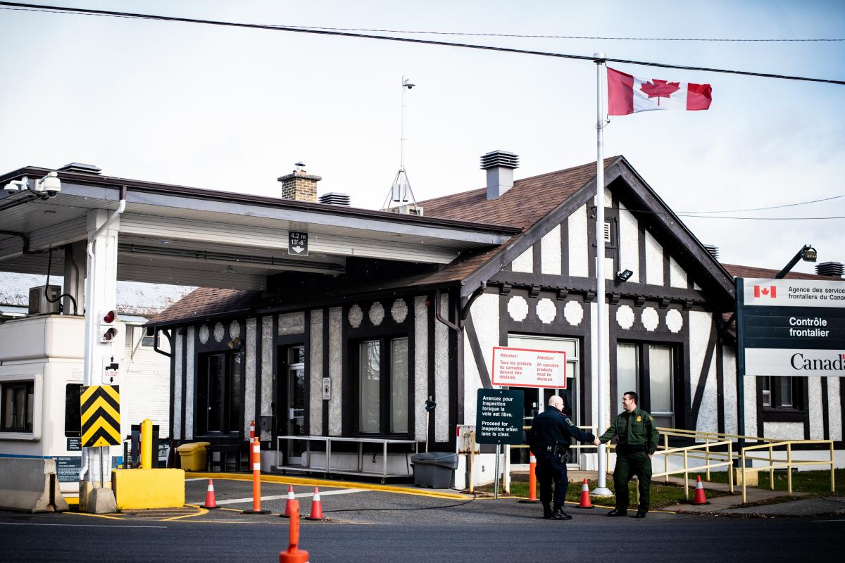 Richard Ross (right), agent in charge of the U.S. Border Patrol's Newport Station, greets a Canadian border agent at the Beebe, Quebec, and Beebe Plain, Vt., crossing.