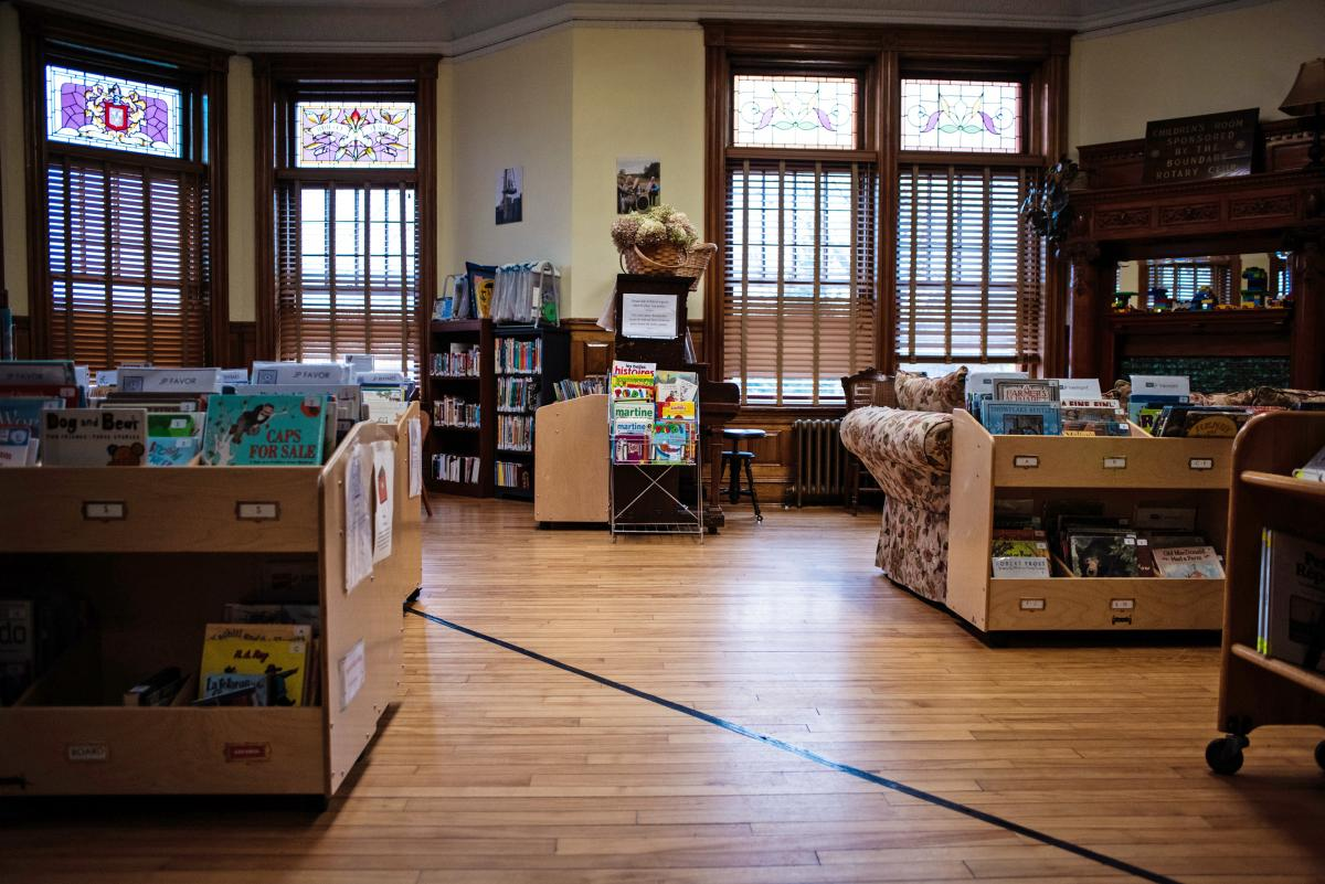 """The Haskell Free Library has a piece of black tape along the floor marking the international boundary. """"The library staff has to keep a sharp eye on who comes and goes,"""" Scott Wheeler, who publishes a local history magazine, says."""