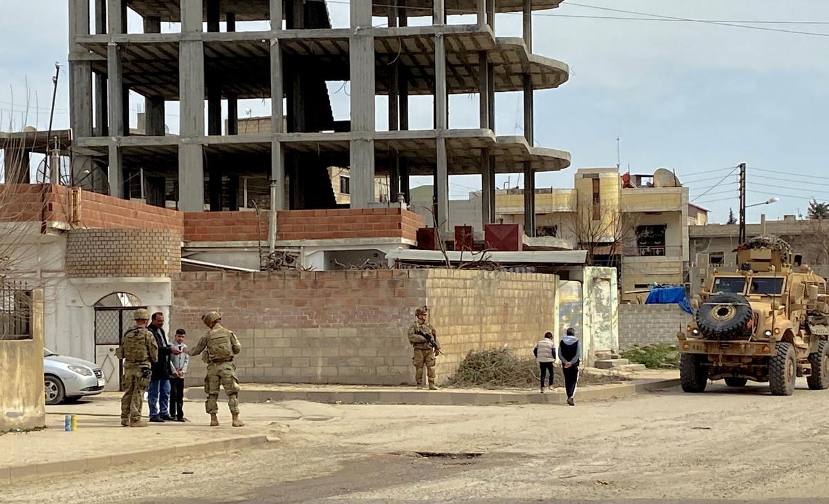 U.S. forces set up a defensive perimeter near Mohammed Abdullah Ismael's shop in Dirik.