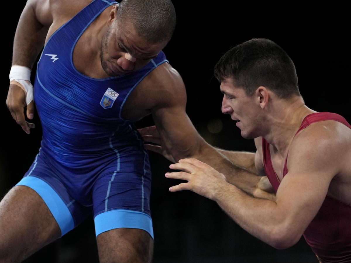Ukraine's Zhan Beleniuk (left) and Hungary's Viktor Lorincz compete during the men's 87-kilogram Greco-Roman wrestling final match at the Olympics on Aug. 4 in Japan.