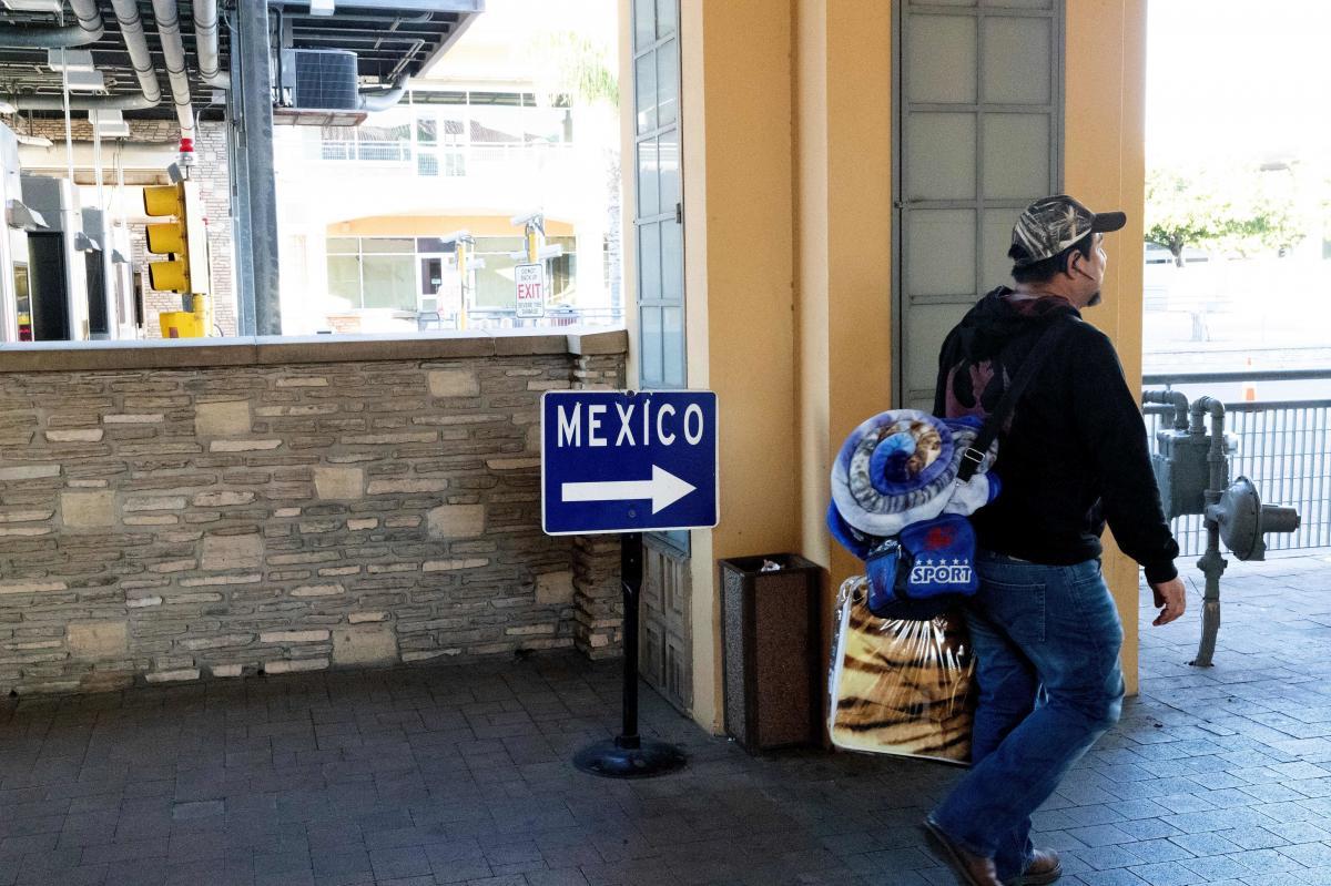 A man prepares to cross the International Bridge towards Mexico on the border in Laredo, Texas, on Jan. 13, 2019.