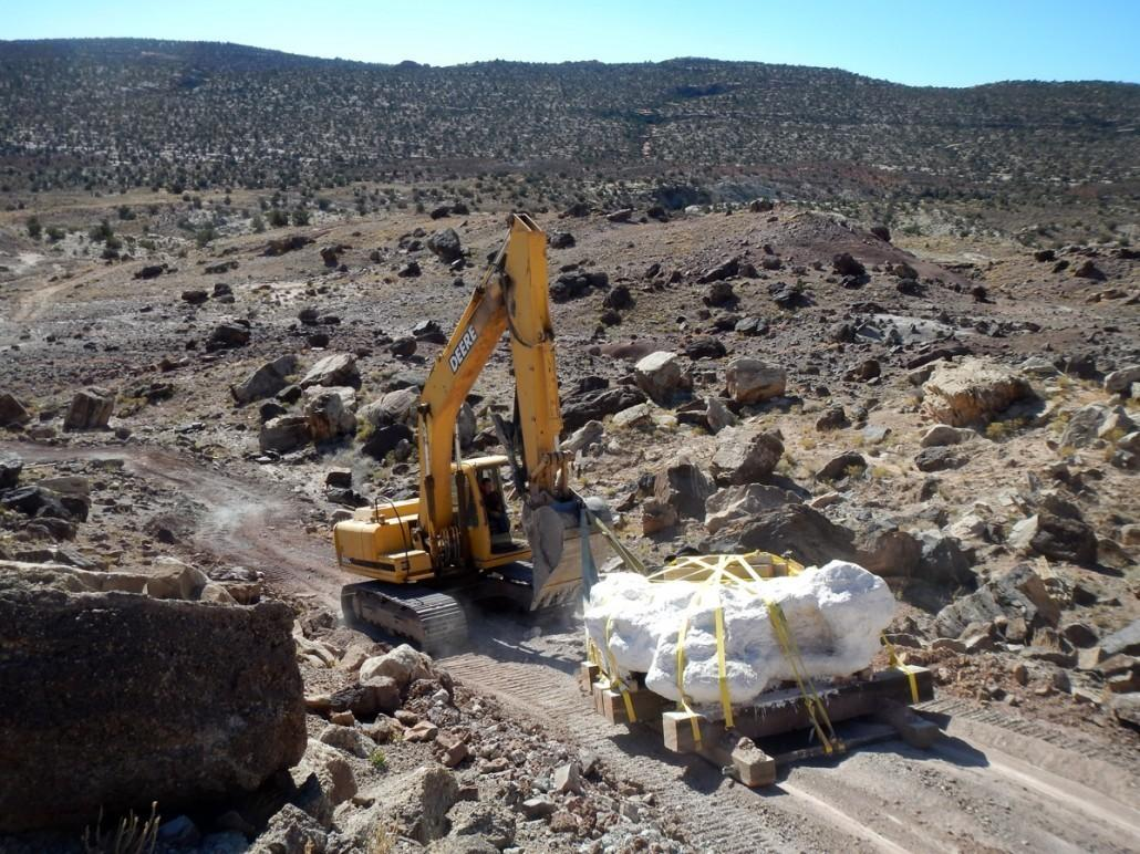 A track hoe pulls the 9-ton megablock containing hundreds of bones of Utahraptor and other dinosaurs from the Stike's Quarry in eastern Utah in 2014.