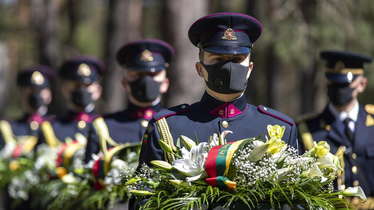 Members of the Lithuanian honor guard mark the 75th anniversary of the end of World War II in Europe at a memorial Friday in Vilnius.