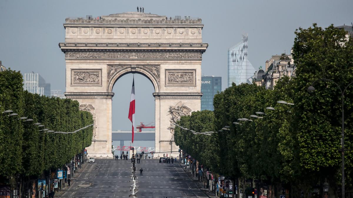 The iconic Champs-Élysées and its Arc de Triomphe stand eerily empty before V-E Day ceremonies Friday in Paris. The 75th anniversary of the end of World War II in Europe, which was expected to be a time for vast parades and celebration, instead unfolded