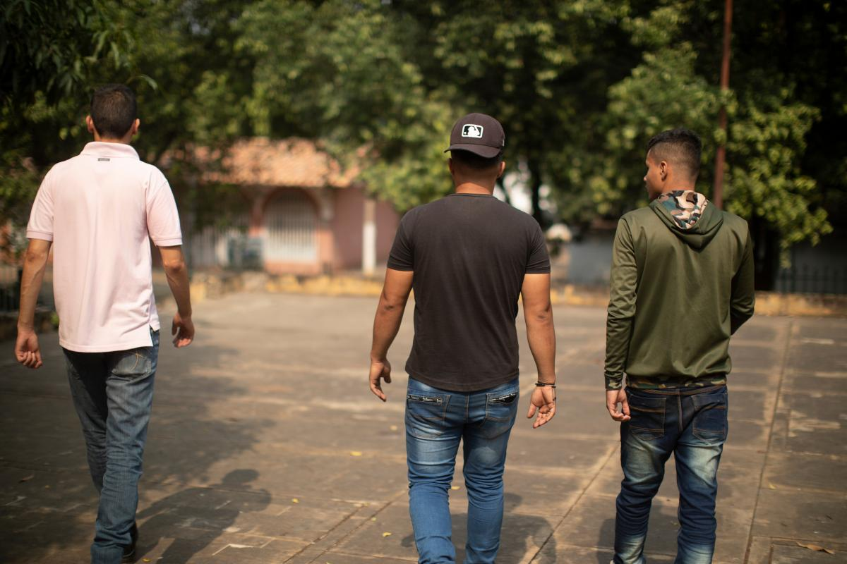 Three of the members of Venezuelan security forces who fled to Colombia walk through the Colombian city of Cúcuta in March.