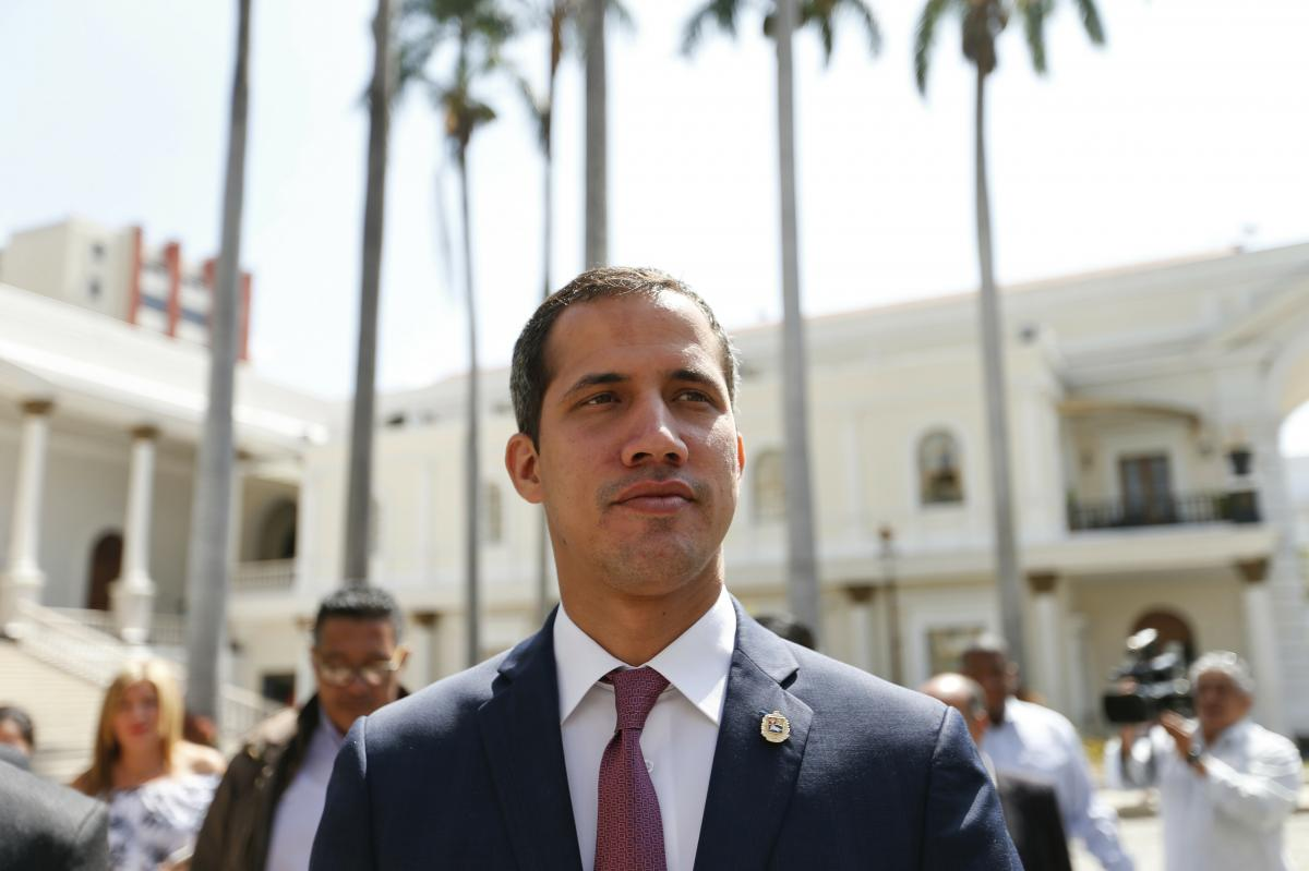 Venezuelan opposition leader Juan Guaidó, who has declared himself interim president, goes to the National Assembly for a meeting with a coalition of opposition parties and civic groups in Caracas on March 18.