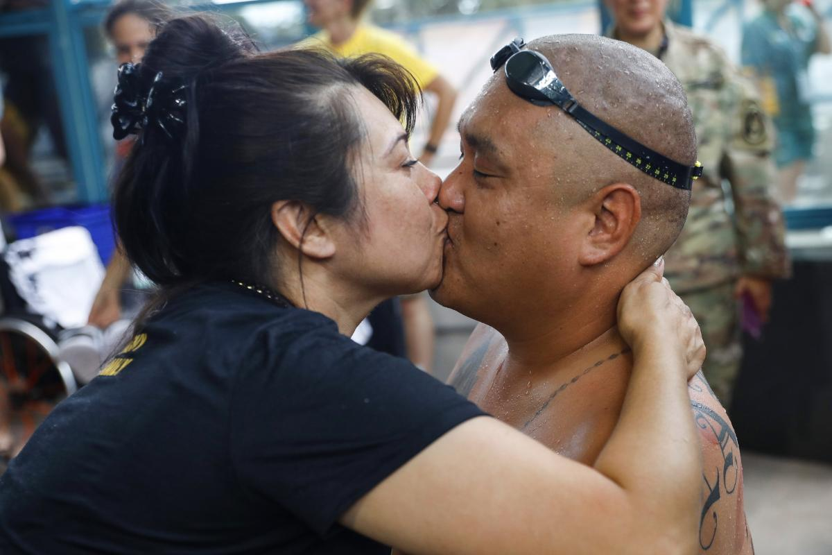 """Alicia and Matt kiss after he competed in a relay event. """"I wouldn't change anything for the world. I'm not complaining. I don't get hung up on injuries,"""" he says."""