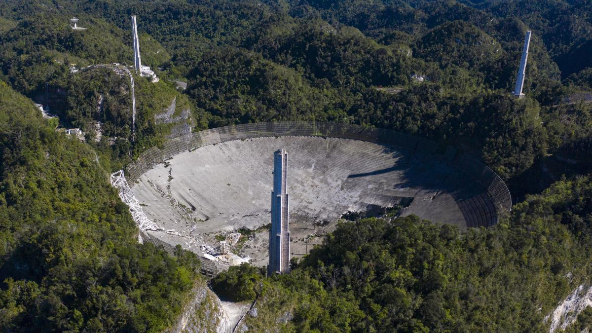 The Arecibo Observatory collapsed when its 900-ton receiver platform fell hundreds of feet, smashing through the radio dish below.