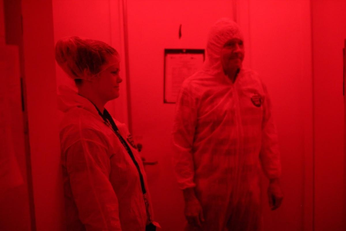 Amanda Stout and Kim Hoelmer, in the quarantine room at the USDA Beneficial Insects Introduction Research Unit in Newark, Del. The room uses red light because insects cannot sense it.