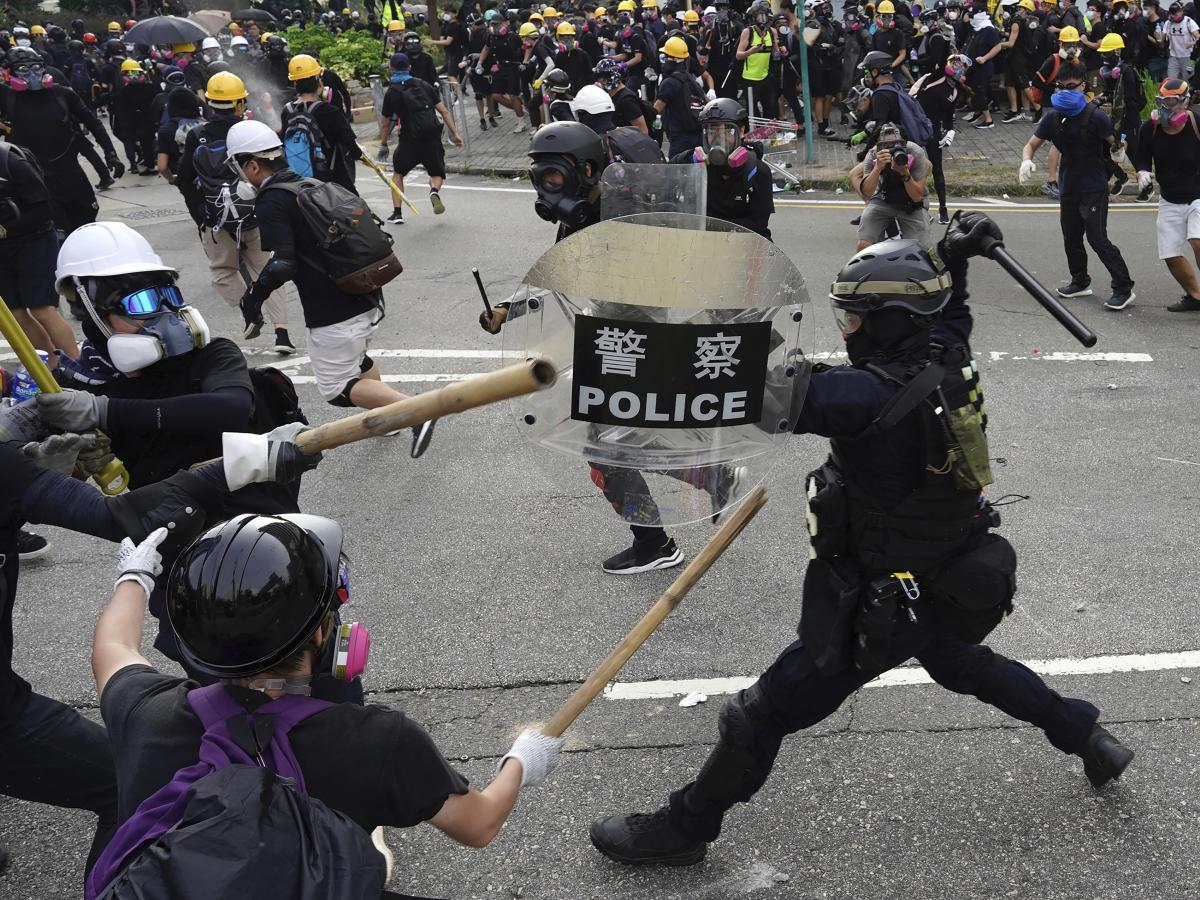 Police and pro-democracy demonstrators clashed during a protest in Hong Kong on Saturday. Protests began in June over an unpopular bill that would have allowed extraditions to mainland China.