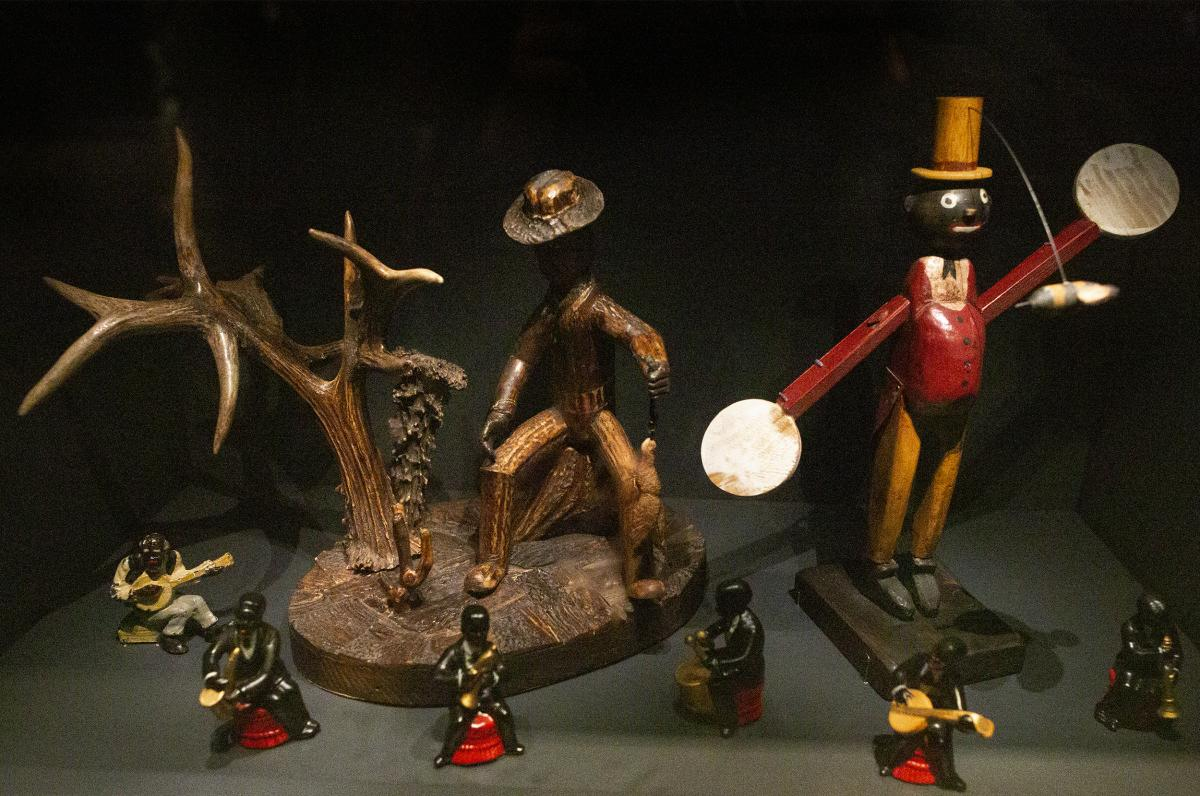 """Objects and figurines perpetuated caricatures of blackface through small, ordinary household displays — many at the expense of exaggerating an """"entertainer"""" persona and one's facial features."""