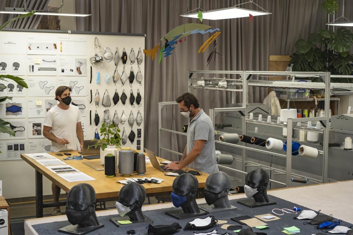 Brothers Billy (left) and Nick Smith collaborate in the Bilio lab on iterations to current mask designs.