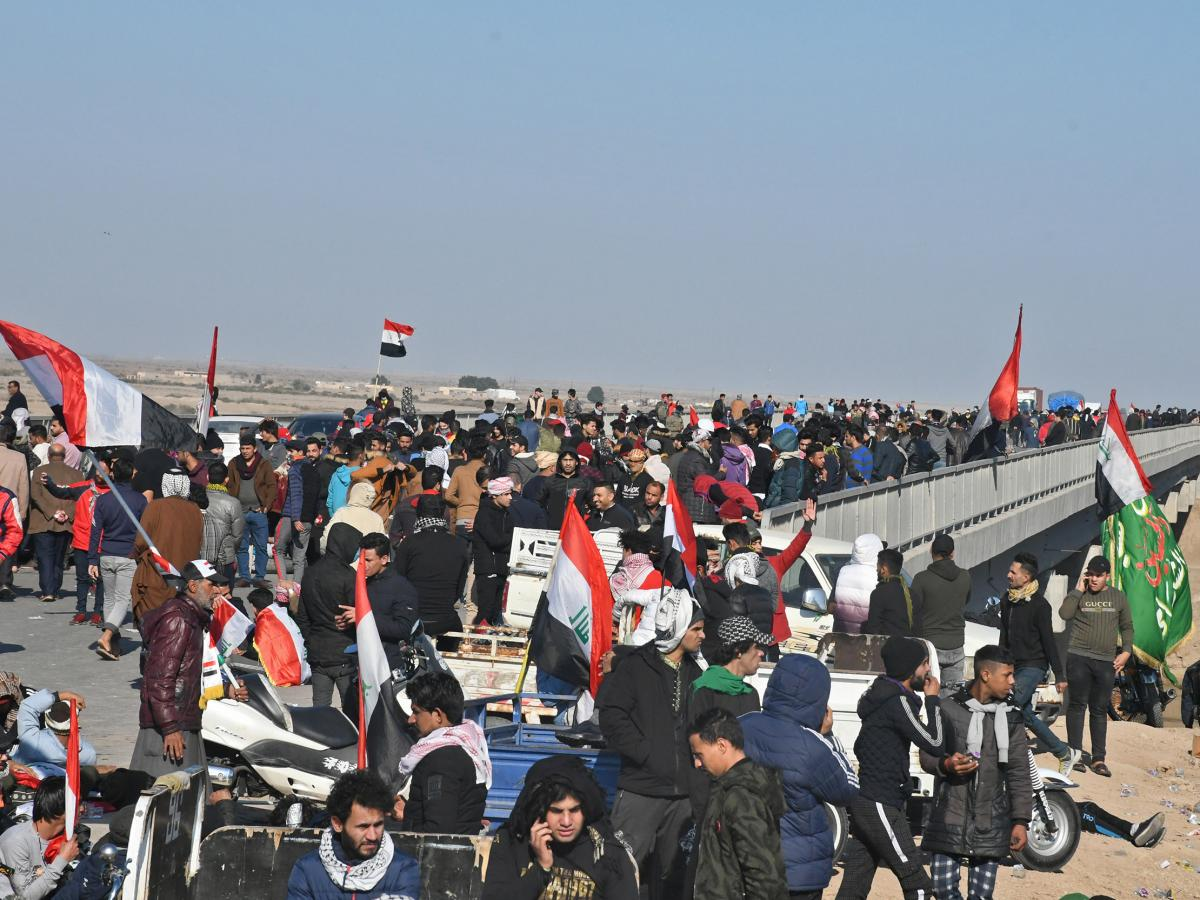 Iraqi protesters block the Fahd bridge on a highway in the southern city of Nasiriyah on Monday, amid ongoing anti-government demonstrations.