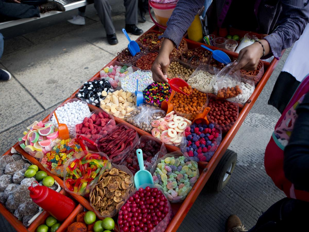 A street vendor sells sweet snacks in Mexico City in 2016. Several states are pushing to ban the sale of junk food and soda to children to improve the population's nutrition levels.