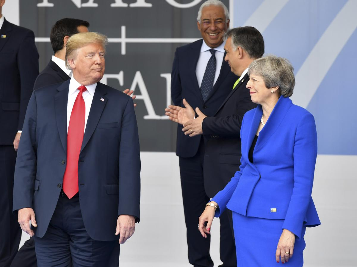 President Trump and British Prime Minister Theresa May, seen during a NATO summit in Brussels on Wednesday, will reconvene this week in the United Kingdom.