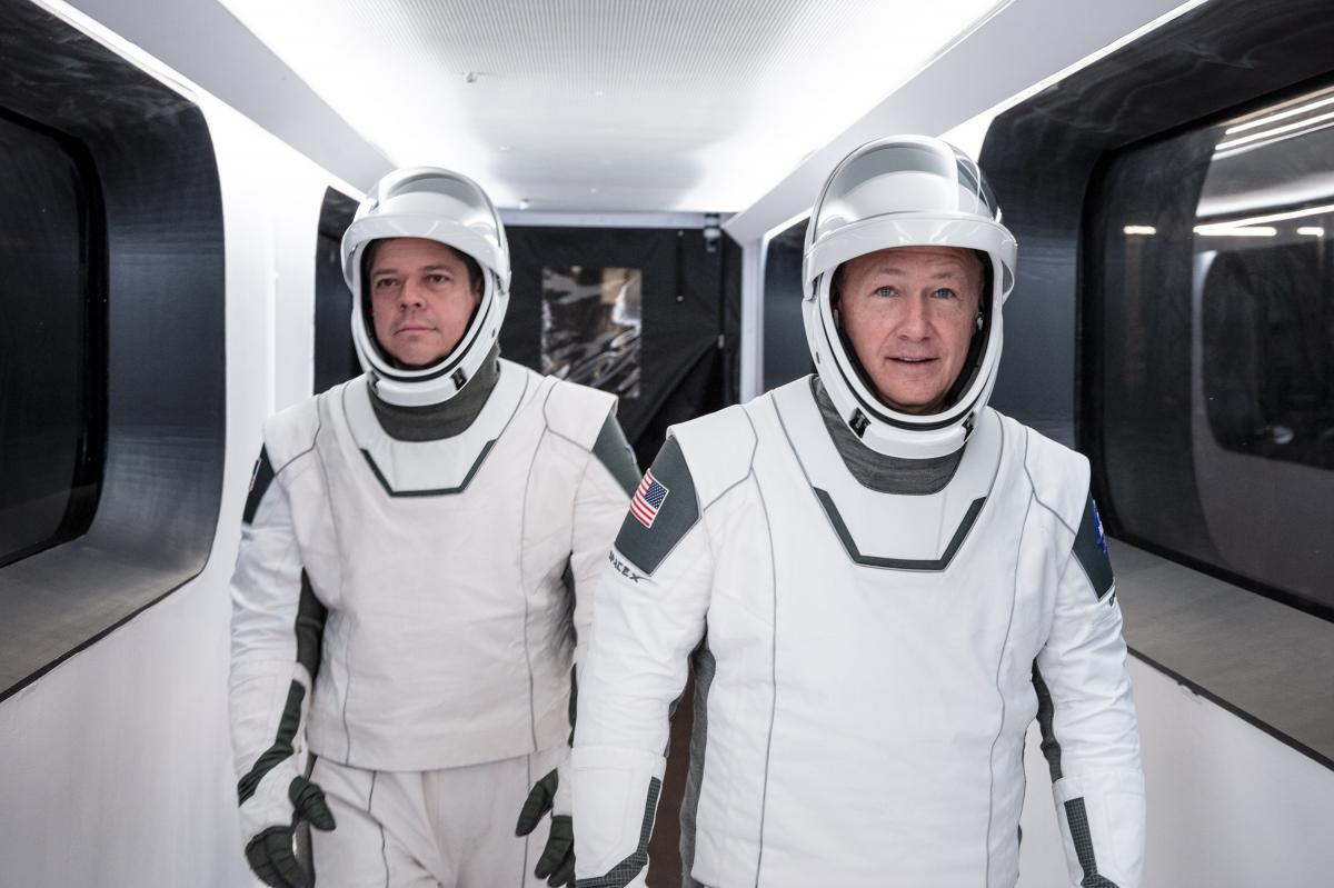 NASA astronauts Bob Behnken (left) and Doug Hurley will have to wait until the weekend, at the earliest, to lift off from NASA's Kennedy Space Flight Center in Florida.
