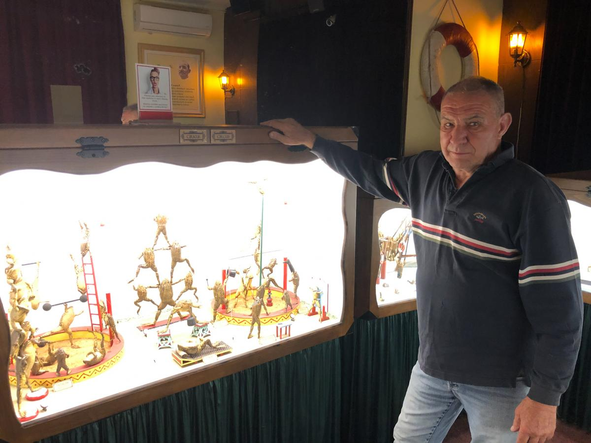 Ivan Medvesek stands in front of one of 21 dioramas in his Froggyland museum. On display is the work of Ferenc Mere, a Hungarian taxidermist who created these exhibits more than a century ago. Medvesek's parents purchased the displays after they were left
