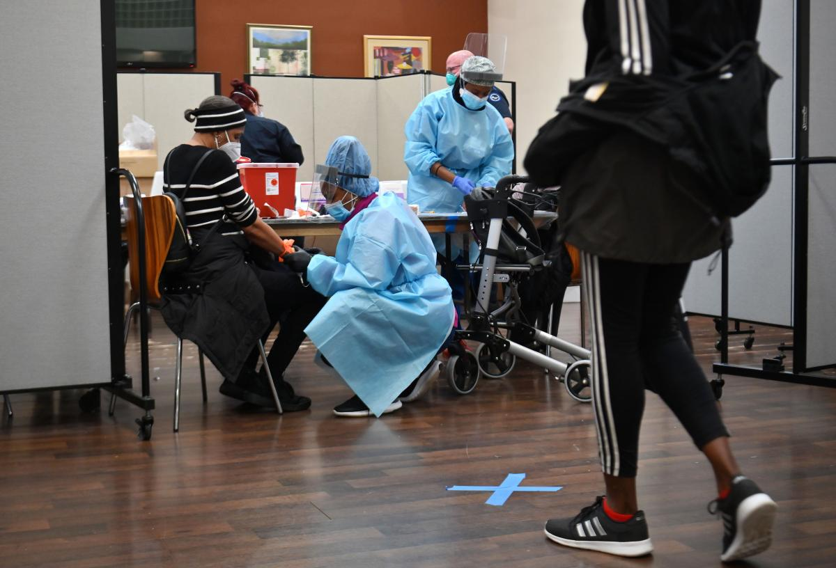 A registered nurse draws blood to test for COVID-19 antibodies at Abyssinian Baptist Church in the Harlem neighborhood of New York City on May 14. Churches in low income communities across New York are offering COVID-19 testing to residents.