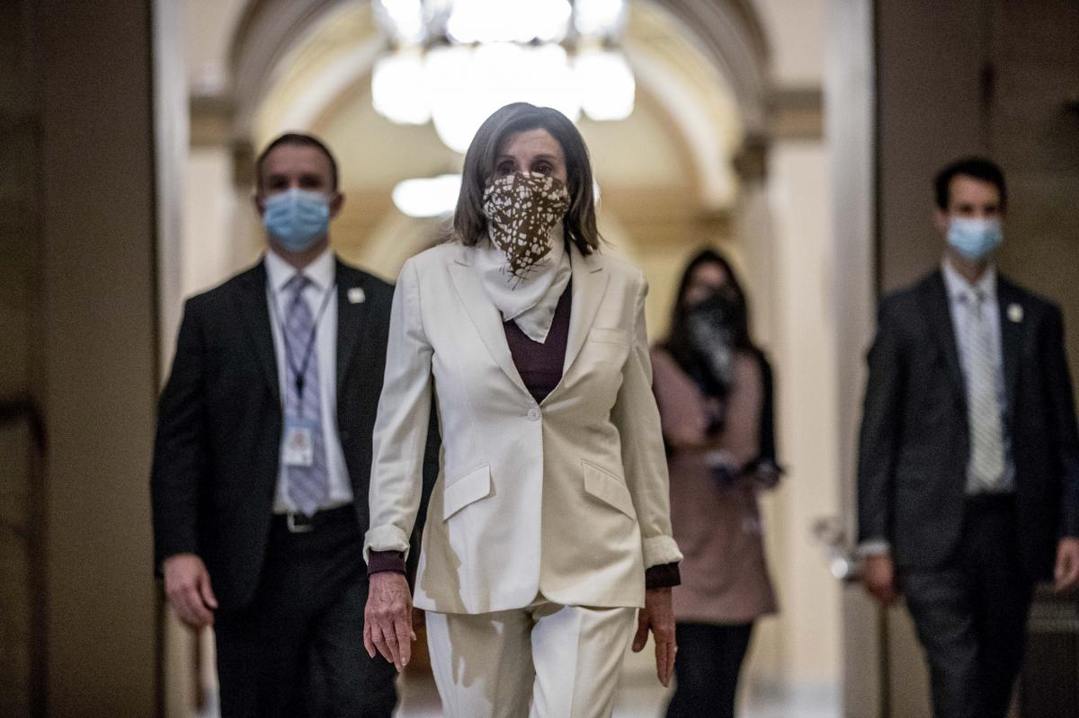 House Speaker Nancy Pelosi walks to her office after signing the Paycheck Protection Program and Health Care Enhancement Act after it passed the House on Capitol Hill on April 23.