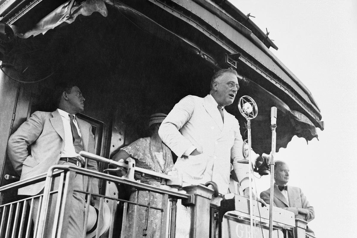 President Franklin D. Roosevelt at Fort Peck, Mont., in August 1934 as he made one of his numerous addresses from the observation platform of his train during his journey over the parched plains of the Northwest.