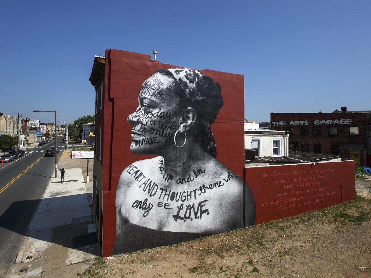 A Philadelphia mural entitled You Go Girl by Jetsonorama and Ursula Rucker. This is just one of many murals that the city's Mural Arts Program helped to create.