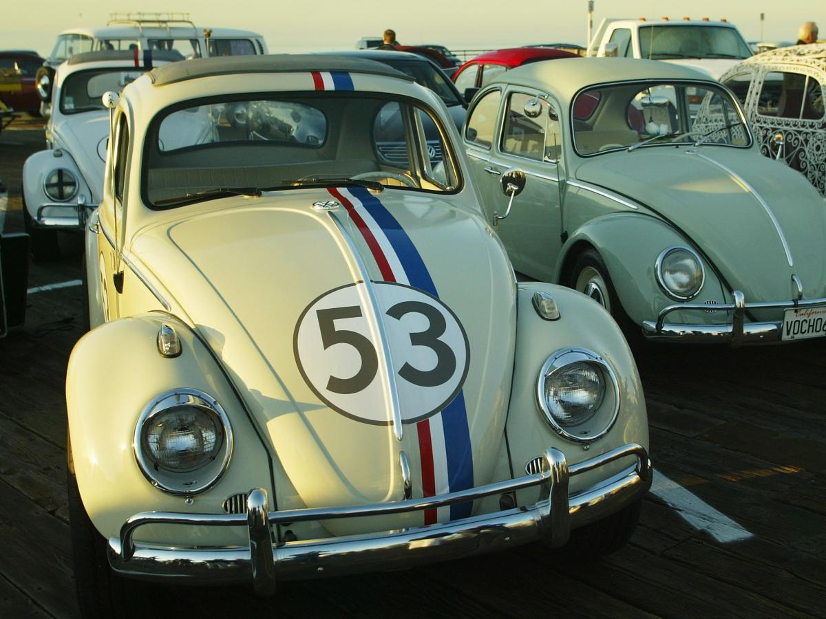 """""""Herbie the Love Bug"""" and other vintage Volkswagens are lined up in 2005 in Santa Monica, Calif., as part of a celebration of VW's 50th anniversary in the U.S."""