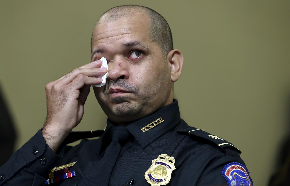 U.S. Capitol Police officer Aquilino Gonell wipes his eyes as he watches a video being displayed during a House select committee hearing on Tuesday.