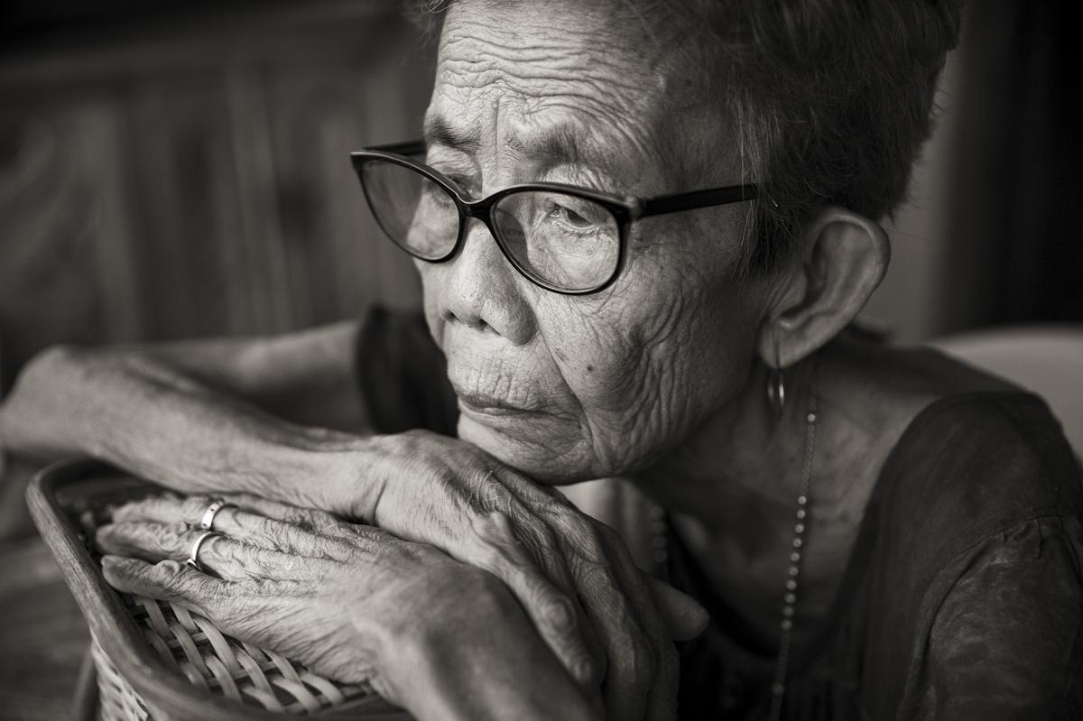 Belen Alarcon Culala looks out on the street in her village of Mapaniqui in Pampanga, Philippines. Culala, who died on Feb. 28, 2021, was one of approximately 100 girls and women who were raped repeatedly by the Japanese Imperial Army soldiers during the