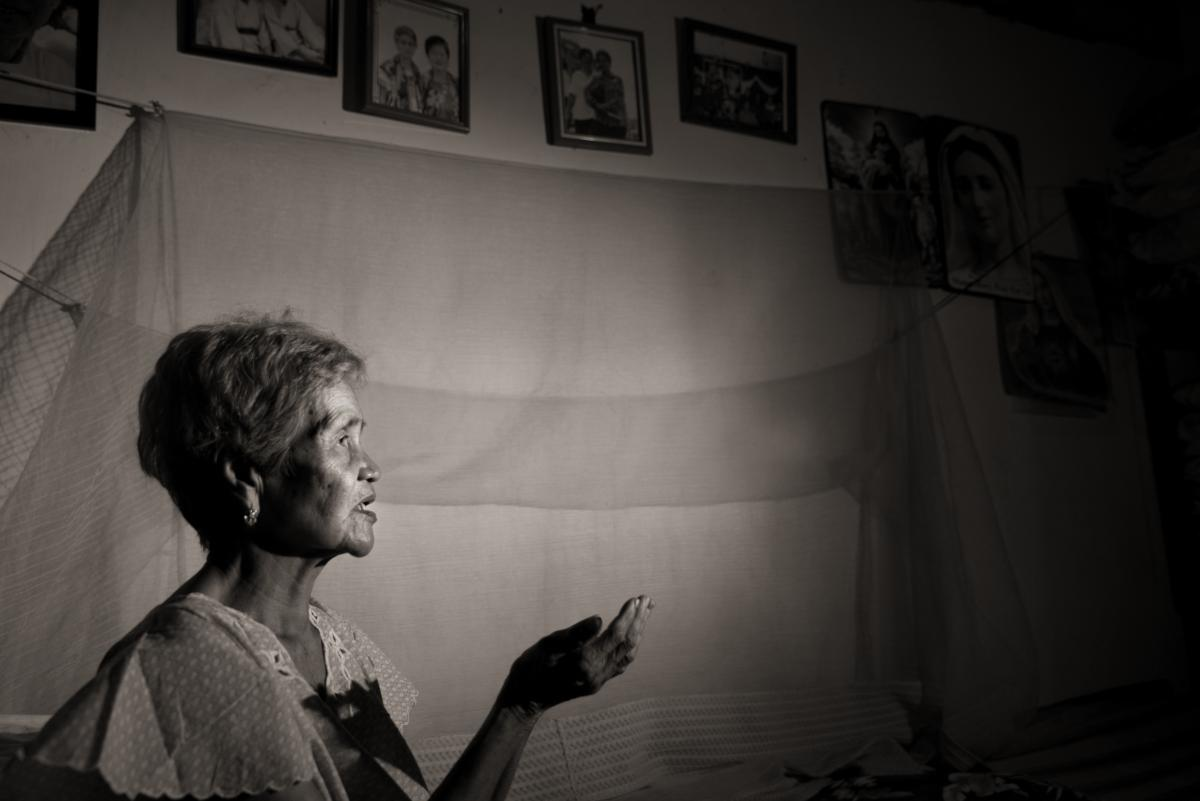 Isabelita Vinuya prays nightly for peace and forgiveness. She was 12 years old when a mass rape took place in her village of Mapaniqui.