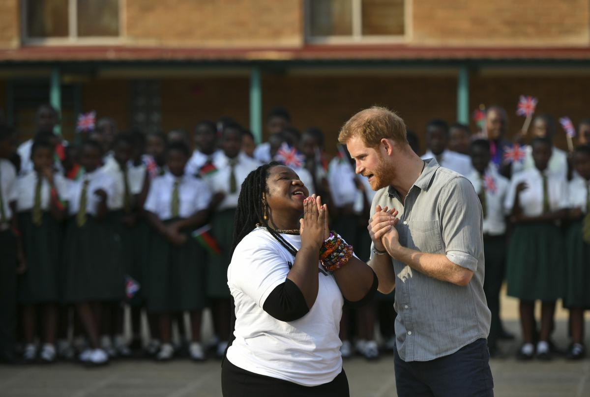 Prince Harry, right, speaks to Murimirwa during his visit to the Nalikule College of Education in Malawi in 2019. The Prince visited the school to learn how the group is supporting young women.