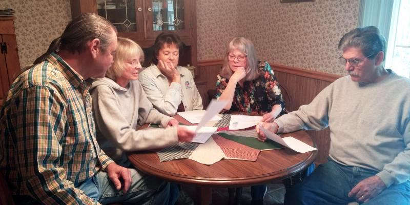 Surry County residents from left, Terry Marshall, Dr. Katherine Kellam, Donna Bryant, Mary Marshall and Jesse Hardy lend support to each other during a meeting at Bryant's home in the Shoals community. Mary Marshall says the odor and pollution from nearby