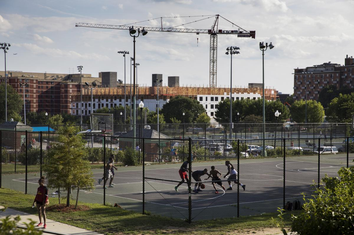 The Sherman Avenue Apartment construction, which is a Howard University co-project, is seen above the courts of the Banneker Recreation Center. Though this development will include some affordable housing, it will also spur further gentrification in the a