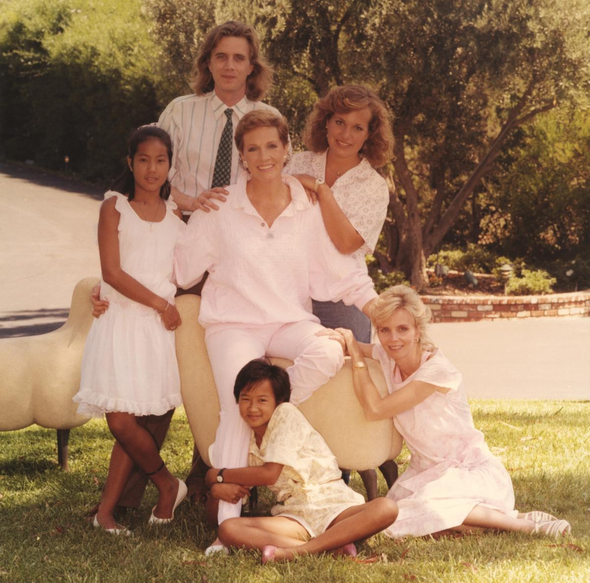 Andrews (center) poses with her children and step-children. Standing from left: Amelia, Geoff and Emma. Seated from left: Joanna and Jennifer.