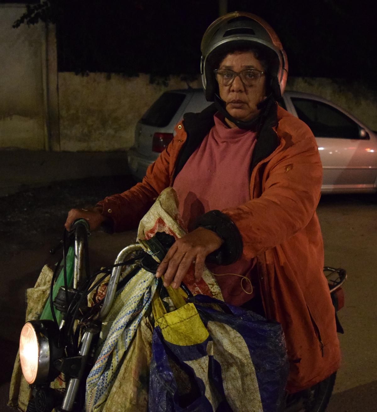 Atika Cherradi drives her motorbike around Rabat disepersing 50lbs of food scraps to the city's stray cats and dogs.