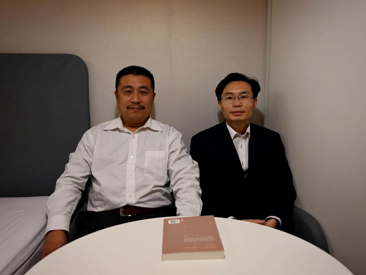 Lawyers Ren Quanniu (left) and Zhang Keke representing Chinese citizen journalist Zhang Zhan, who reported on Wuhan's coronavirus outbreak and was detained in May, during an interview with Agence France-Presse on Dec. 27 in Shanghai ahead of their client'