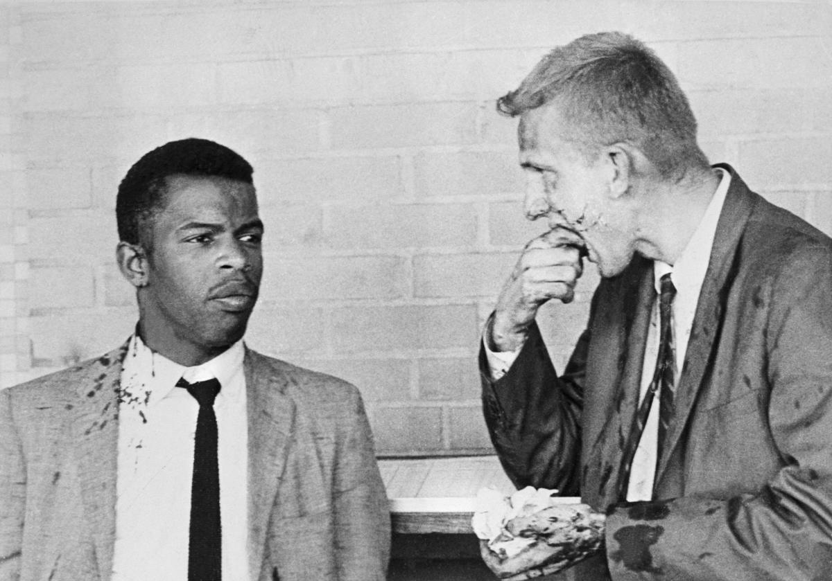Two blood-splattered Freedom Riders, John Lewis and James Zwerg, stand together after segregationists attacked them in the early 1960s in Montgomery, Ala. Lewis, then a young civil rights activist, would later become a member of Congress from Georgia.
